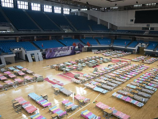 Beds are set up in the Hongshan Gymnasium in Wuhan in central China's Hubei Province to help provide extra beds for those afflicted with the virus. Picture: Xiong Qi/Xinhua via AP.