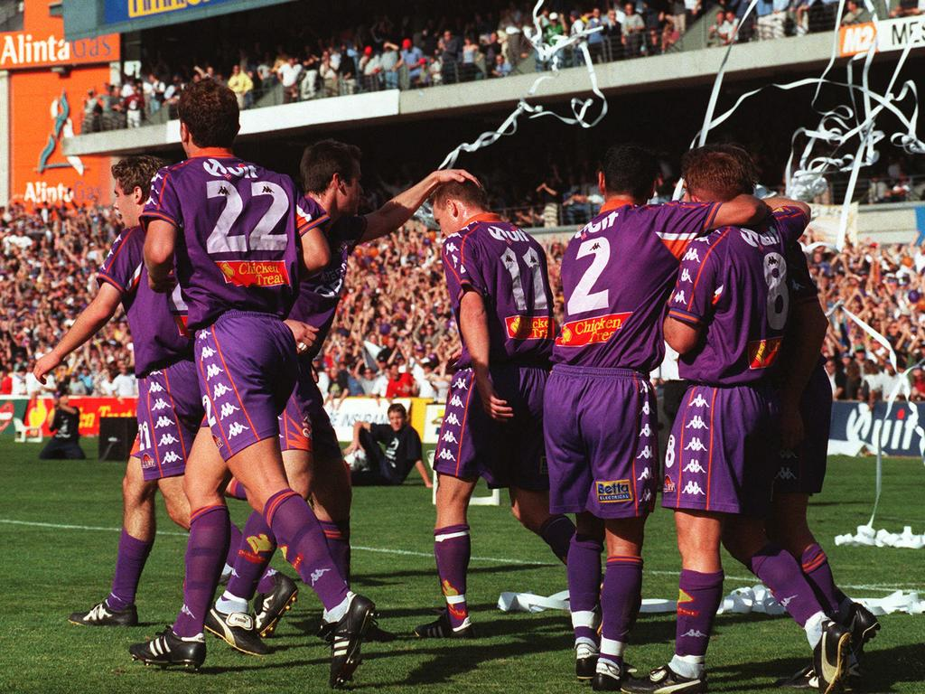 Player Bobby Despotovski congratulated by team mates after scoring goal. Soccer - Perth Glory vs Wollongong Wolves NSL Grand Final match in Perth 11 Jun 2000.
