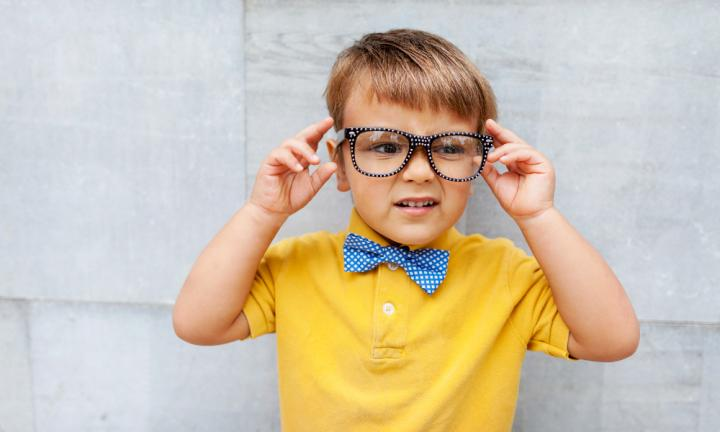 little boy with eyewear and blue bow tie