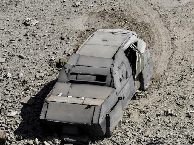 An unexploded car bomb is seen on the western frontline of Raqa after its driver was shot by members of the Syrian Democratic Forces (SDF). Picture: AFP