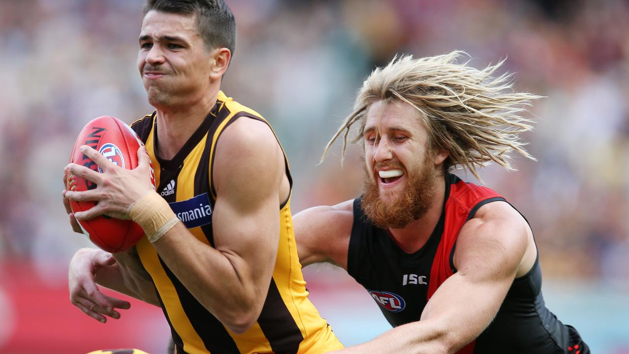 Ryan Burton is tackled by Essendon's Dyson Heppell this year.