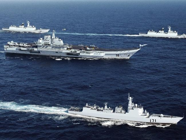 China's training aircraft carrier Liaoning is surrounded by her protective escorts in an earlier exercise.