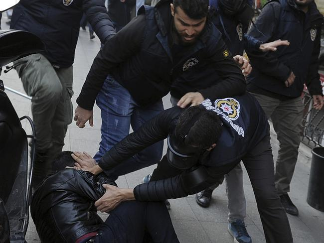 Security officers detain a protester in Istanbul. Picture: AP