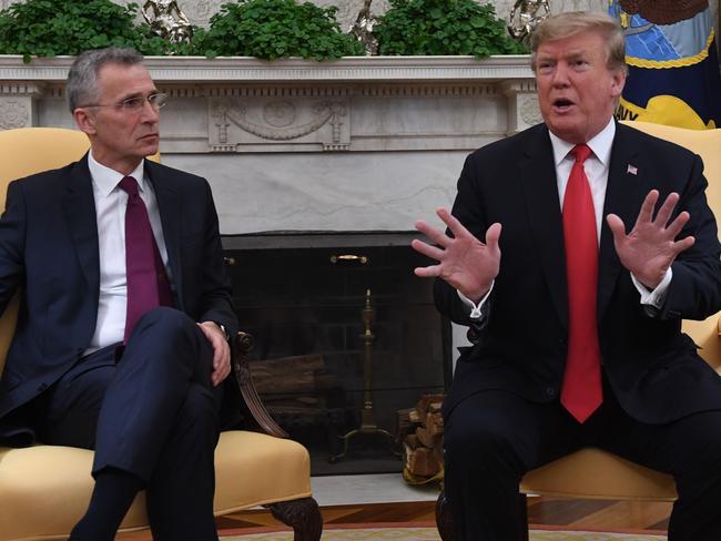 US President Donald Trump speaks as NATO secretary-general Jens Stoltenberg looks on at the White House in Washington, DC on April 2, 2019.