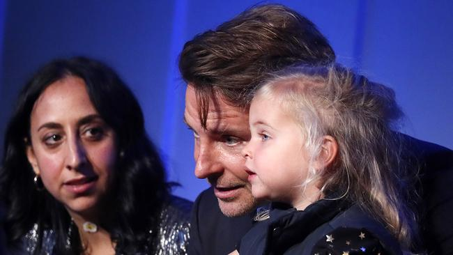 In one photo, she appeared to lean in and ask her dad a question. Picture: Getty Images.