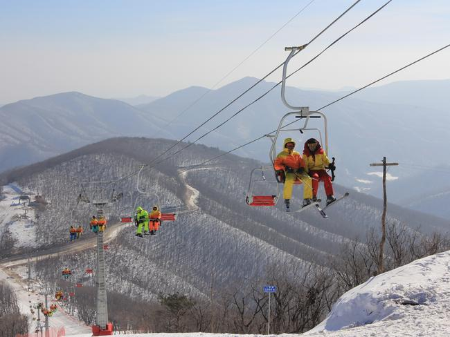 North Korean students ride a chair lift at the Masik Pass Ski Resort which opened in 2014. Picture: Jean H. Lee/Getty Images
