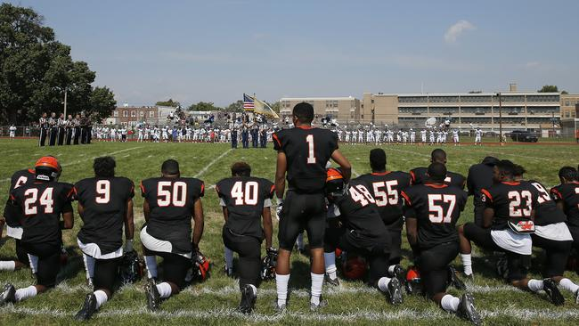 Woodrow Wilson High's Edwin Lopez stood while the rest of his teammates knelt.