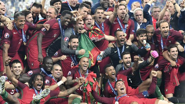 Portugal players celebrate after winning the Euro 2016 final.
