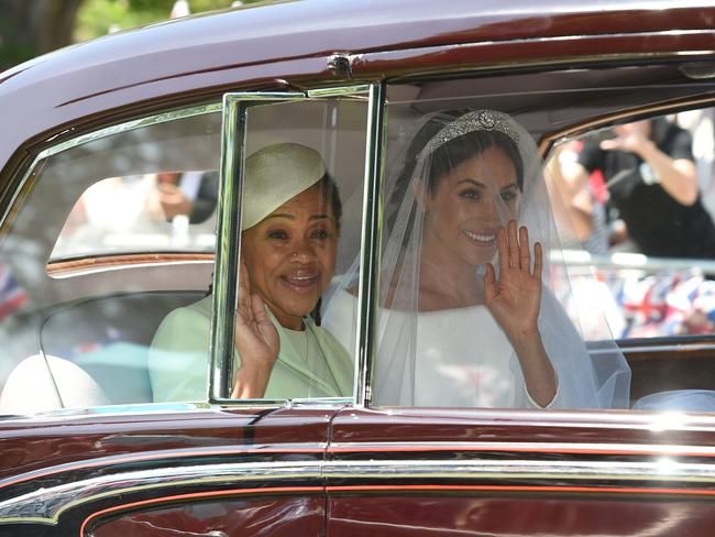 Mother of the bride, Doria Ragland, with her daughter, Meghan.