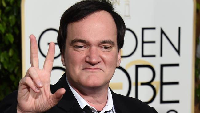 Gesturing ... We're not entirely sure what The Hateful Eight director Quentin Tarantino is trying to say here. Picture: AFP/ Valerie Macon