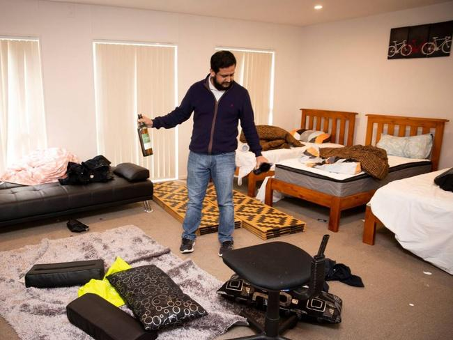 Ravi Punjwani assess the damage to his Auckland home. Picture: Dean Purcell/NZ Herald