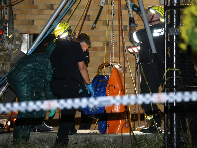 Authorities on the scene in Brisbane yesterday. Picture: AAP/image David Clark
