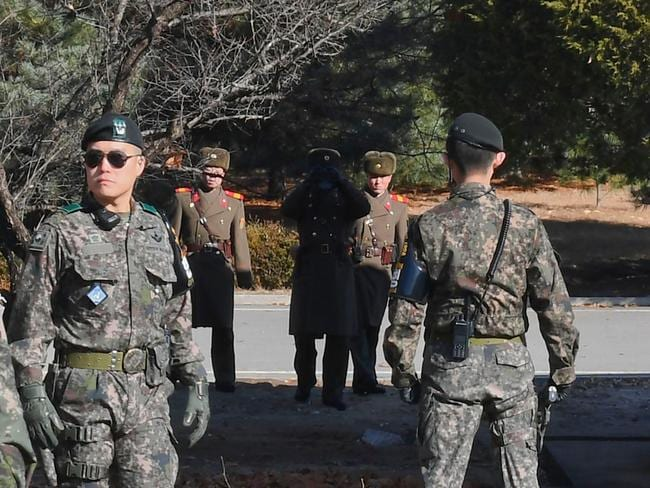 North Korean soldiers stare at South Korean soldiers at Panmunjom in the Demilitarised zone (DMZ). Picture: AFP