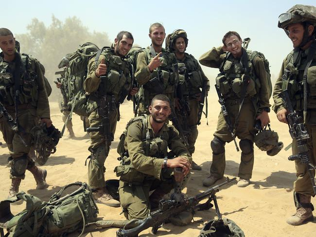Israeli soldiers from the Paratroop battalion return to Israel from Gaza strip, southern Israel, on Monday, after a brief ceasefire. Pic: AP Photo/Tsafrir Abayov