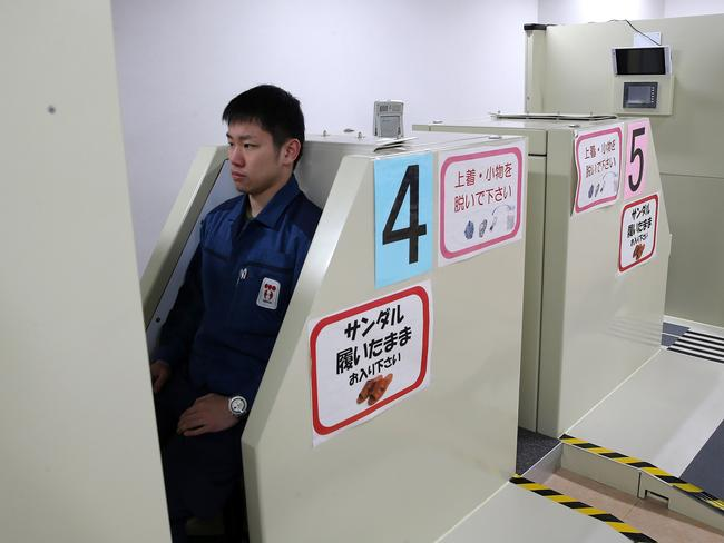 A worker undergoes a radiation dosage core body scan before dressing in protective clothing and venturing out into the radiation zone. Picture: Getty