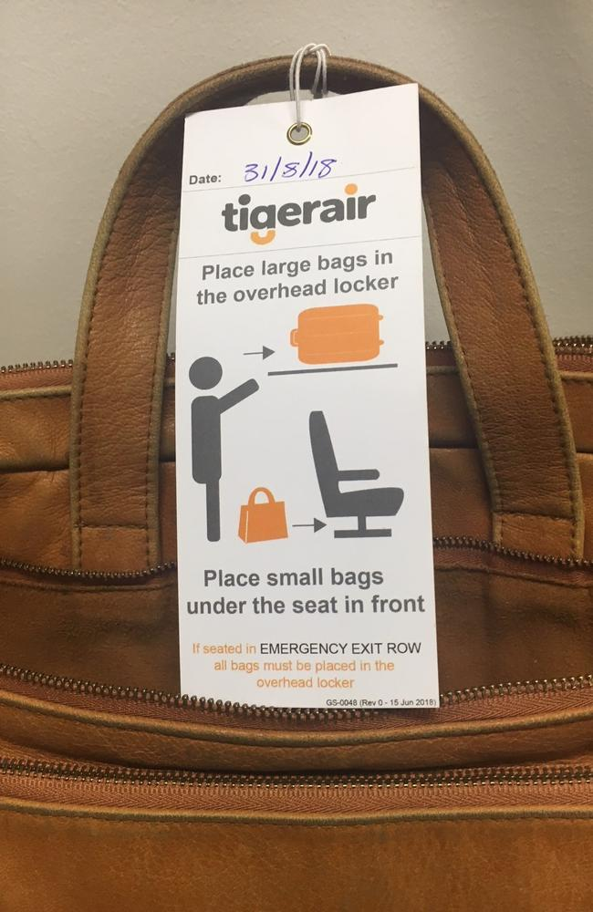 The tags also explain how passengers should stow their bags. Picture: Tigerair Australia