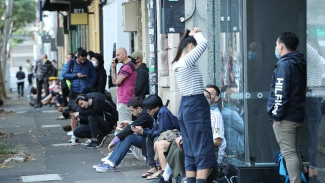 A queue forms outside the Darlinghurst Centrelink office yesterday morning, long before the office is due to open. Picture: Rohan Kelly