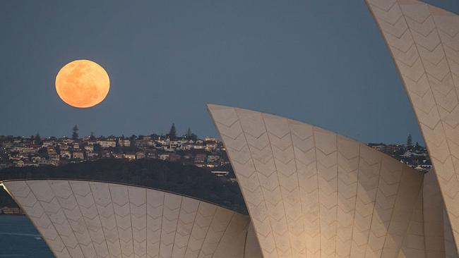 A smaller supermoon to Monday's supermoon rises above the Sydney skyline in September 2015.