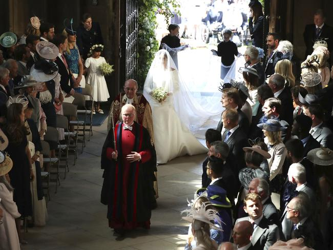 Meghan Markle walks down the aisle. Picture: AP