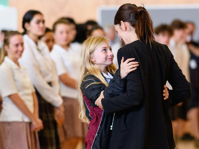 New Zealand Prime Minister Jacinda Ardern receives a hug from a student during her visit to Cashmere High School, which lost two students during the mass shooting. Picture: Kai Schwoerer/Getty Images