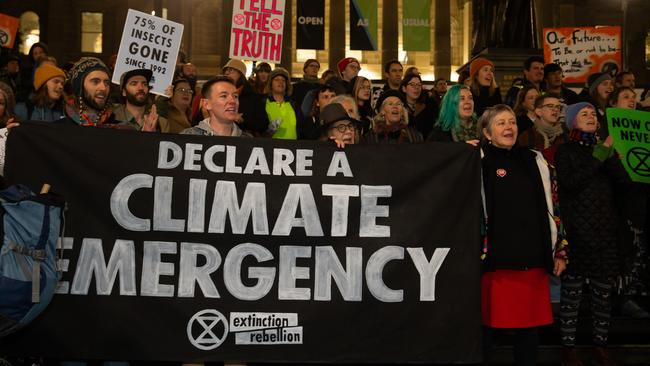 Extinction Rebellion signs outside the State Library after the march up Swanston Street. Picture: Sarah Matray