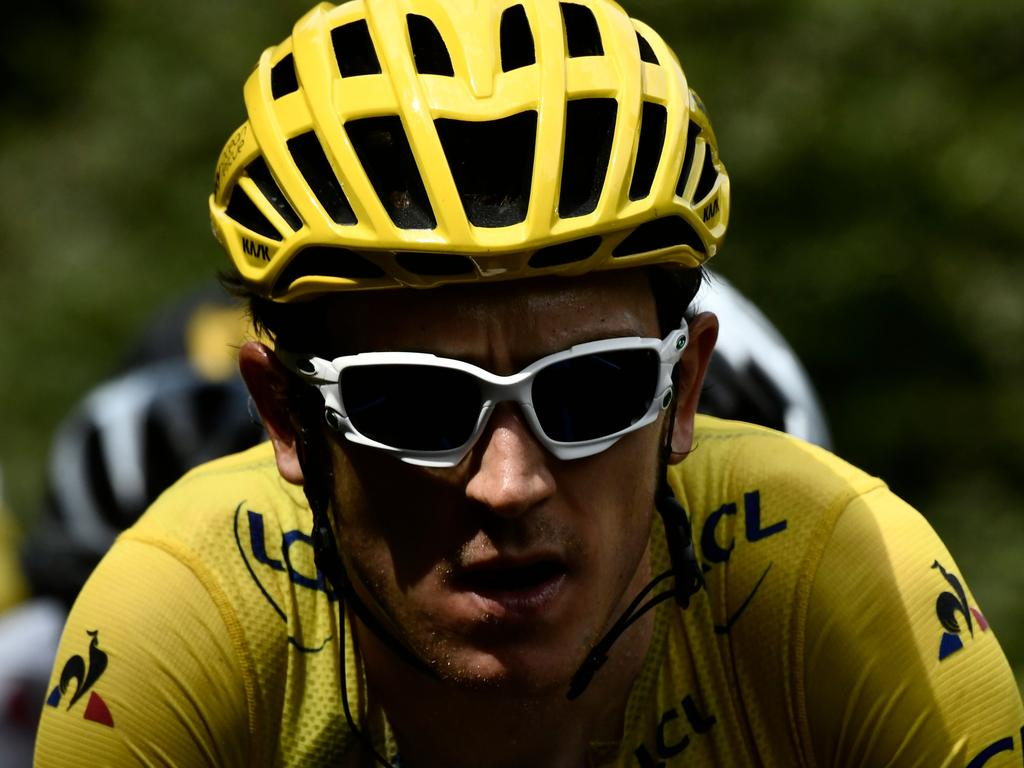 Great Britain's Geraint Thomas, wearing the overall leader's yellow jersey, rides during the 19th stage of the 105th edition of the Tour de France cycling race, on July 27, 2018 between Lourdes and Laruns, southwestern France. / AFP PHOTO / Philippe LOPEZ