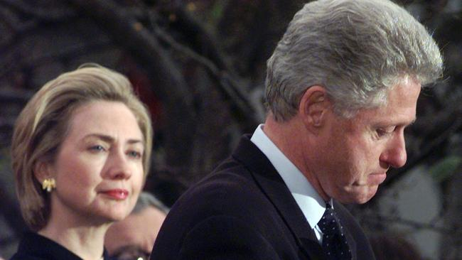 Then-First Lady Hillary Rodham Clinton watches President Bill Clinton pause as he thanks those Democratic members of the House of Representatives who voted against impeachment in 1998. Picture: AP