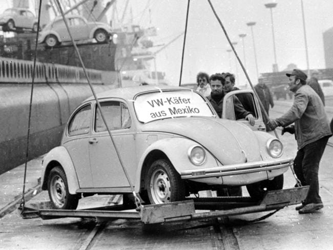 A Volkswagen Beetle is unloaded in Germany in 1977, as the first shipment of 1600 Beetles made in Mexico arrives. Picture: AP/Heinz Ducklau
