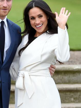 Meghan waves to photographers. Picture: Eddie Mulholland/Pool via AP