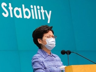 HK leader says laws won't affect freedoms
