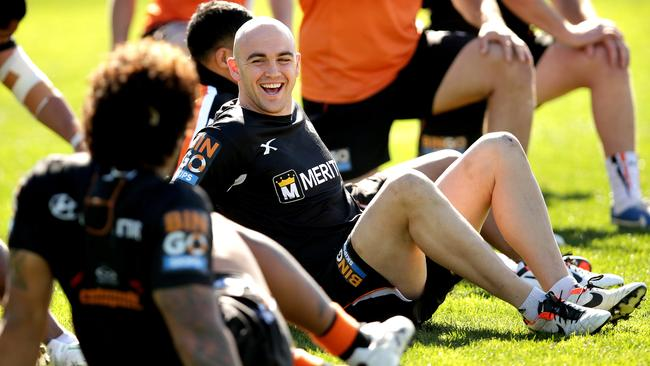 Liam Fulton is all smiles during West Tigers training at Concord Oval.
