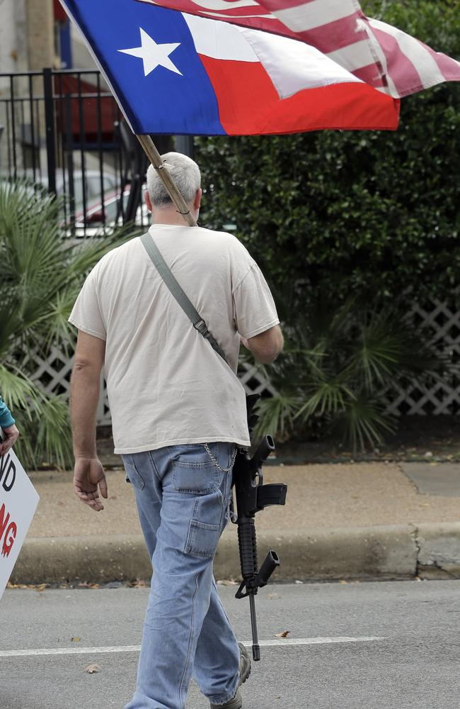 The open carry laws in many US states would shock Australians. This man in Texas is perfectly legally carrying around his gun while protesting against private schools not allowing handguns on campus. Picture: Eric Gay, AP