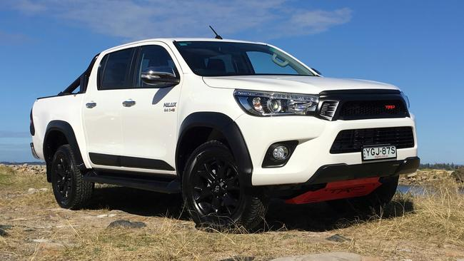 The finishing touches on the Toyota HiLux TRD edition are added at the dealership. Picture: Joshua Dowling.