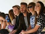 David Beckham and his son Brooklyn and Vogue magazine editor Anna Wintour with daughter Bee Shaffer attend the Victoria Beckham Spring Summer 2017 show on September 11, 2016 at New York Fashion Week. Picture: AFP
