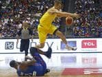 Australia's Nathan Sobey jumps over the Philippines' Andray Blache during the FIBA World Cup Qualifiers Monday, July 2, 2018 at the Philippine Arena in suburban Bocaue township, Bulacan province north of Manila, Philippines. Australia defeated the Philippines 89-53 via default following a brawl in the third quarter. (AP Photo/Bullit Marquez)