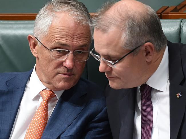 Australian Prime Minister Malcolm Turnbull and Australian Treasurer Scott Morrison confer while listening to the speech on Thursday night. Picture: AAP Image/Lukas Coch