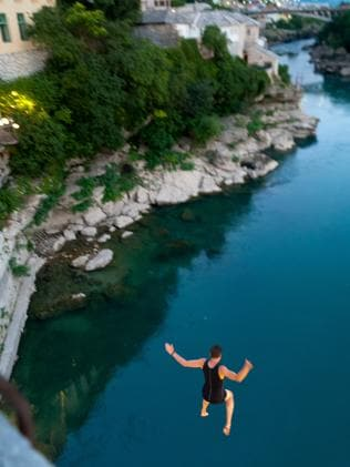 A man is free fall after jumping off the old bridge in Mostar.