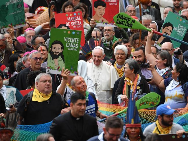 The Amazon Rainforest's ethnic groups and Pope Francis (C) march during the opening of the Special Assembly of the Synod of Bishops for the Pan-Amazon Region. Picture: AFP