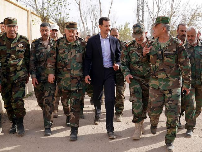 Syrian President Bashar al-Assad in Eastern Ghouta, in the leader's first trip to the former rebel enclave. Picture: AFP/Syrian Presidency Facebook page