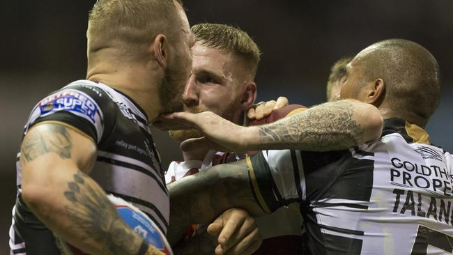 Sam Tomkins is involved in a scuffle.