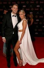 Ben Reid of Collingwood and Erin Jolley on the Brownlow red carpet.