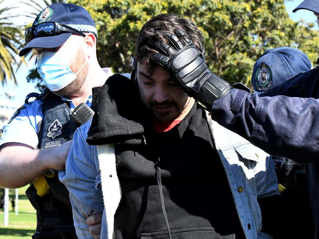 Police arrest a man at Saturday's protest in the CBD.