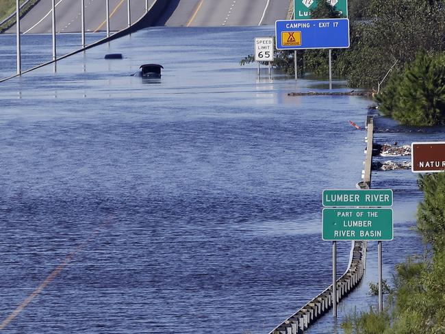 The Lumber River overflows onto a stretch of highway in Lumberton, North Carolina. Picture: AP