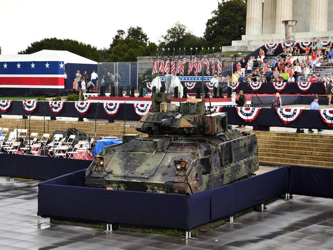 A Bradley Fighting Vehicle is seen as people gather for the parade. Picture: Nicholas Kamm