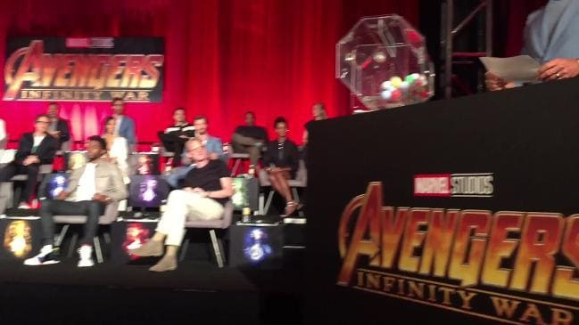 RAW: Hemsworth and Avengers co-stars squeeze on stage for junket