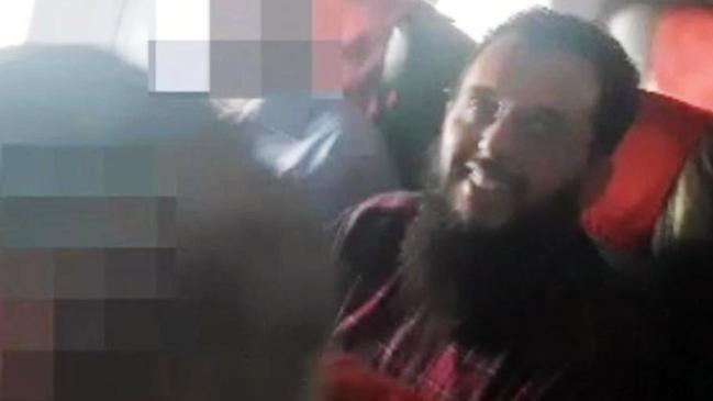 Mounir El-Motassadeq grinning on the deportation flight after his early release. Picture: CEN/Australscope