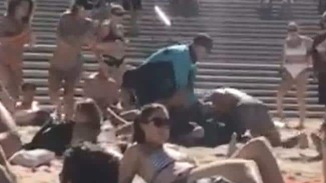 There was a loud cheer as the man face planted into the sand. Picture: Tom Davies