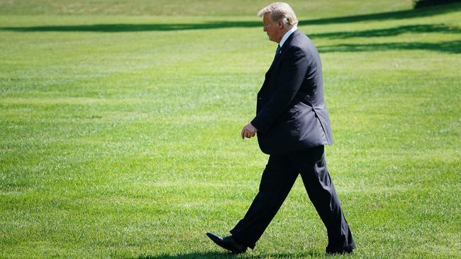 Donald Trump strikes a lonely figure on the White House lawn. Picture: Mandel Ngan/AFP