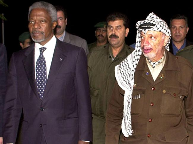 Kofi Annan with former Palestinian (PLO) leader Yasser Arafat at Gaza city in 2000. Picture: AP