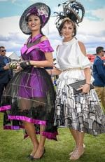 Melbourne Cup 2016: Evelyn Lewis with designer and milliner Peta Schaefer. Picture: Jake Nowakowski